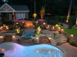 Outdoor lighting on patio and pool area