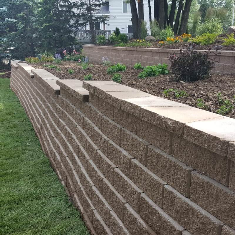 Two-tierd retaining wall with raised flowerbed