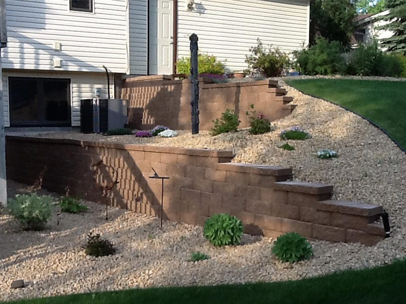 Retaining wall and rock garden with shrubs