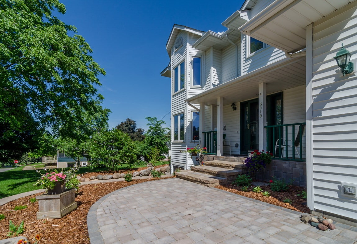 Paver stone steps and patio in entrance to home